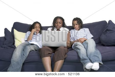 Three Siblings On The Computer