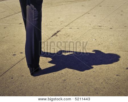 Lady With Shadow In A Street