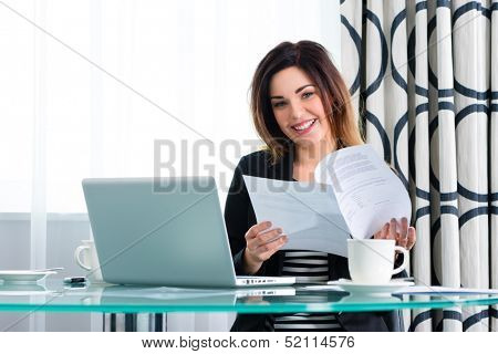 Businesswoman working in business hotel, maybe she working on a contract or using wifi for the computer