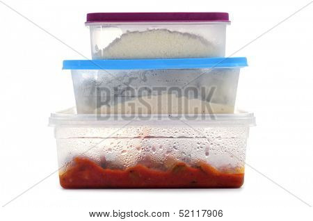 a pile of plastic containers with food on a white background