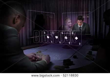 People gambling on table in purple light with holographic card display in dark room