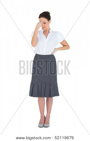 Uneasy gorgeous businesswoman posing on white background
