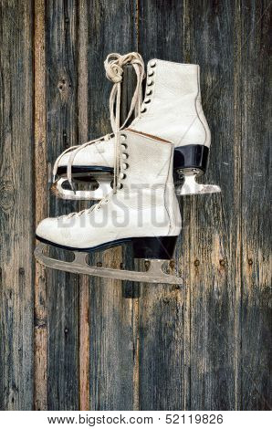 Old ice skates on wall