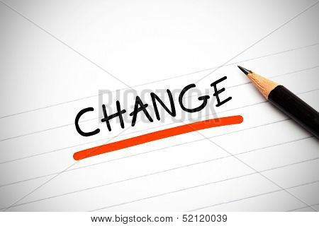 The word change written on a notepad with a pencil and underlined in red