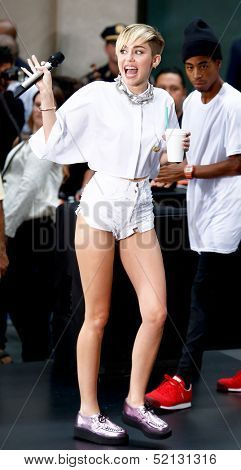 NEW YORK-OCT 7: Recording artist Miley Cyrus waves to the crowd before performing on NBC's 'Today Show' at Rockefeller Plaza on October 7, 2013 in New York City.