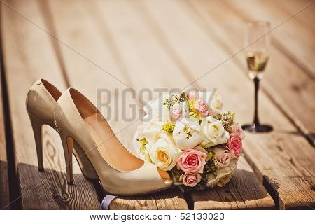 Wedding bouquet and bride shoes