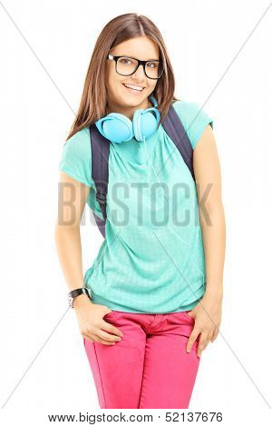 Smiling female with schoolbag and headphones looking at camera, isolated on white background