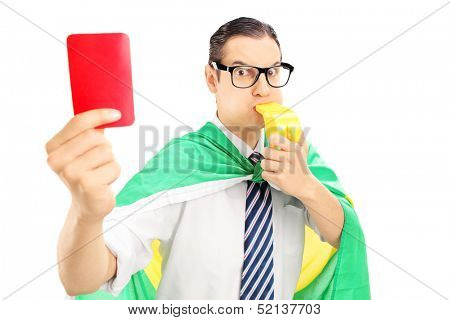 Euphoric male fan with flag of Holland holding a red card and blowing a whistle isolated on white background