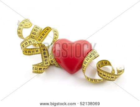Red heart with yellow tape measure. Clipping path included.
