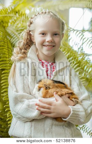 Portrait of smiling little girl posing with pet
