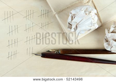 Counting days by drawing sticks on paper on wooden background