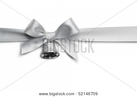Silver ribbon bow with jingle bell isolated on white background