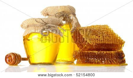 sweet honeycombs, wooden drizzler, and jars with honey, isolated on white