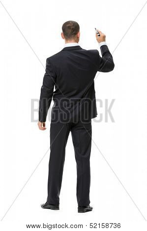 Full-length backview portrait of businessman writing with marker, isolated on white. Concept of leadership and success