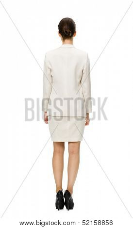 Full-length backview of businesswoman, isolated on white. Concept of leadership and success