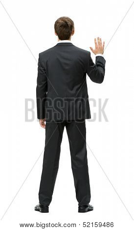 Full-length backview of businessman waving hand, isolated on white. Concept of leadership and success