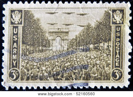 stamp printed in USA show USA Army on the Champs Elysees under the Arc de Triomphe in Paris