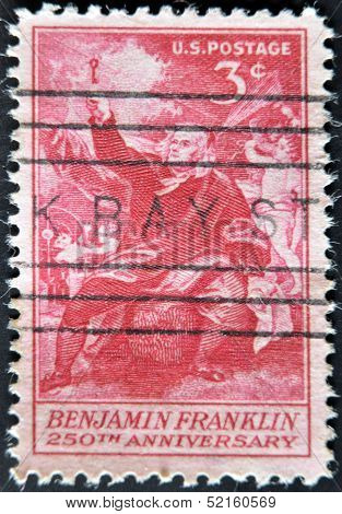 A stamp printed in the USA shows image of President Benjamin Franklin