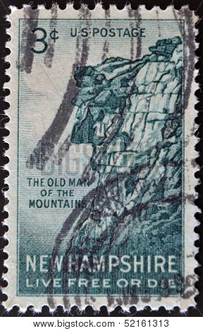 stamp printed in USA shows Great Stone Face New Hampshire live free or die