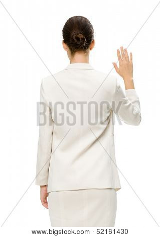 Backview of businesswoman waving hand, isolated on white. Concept of leadership and success