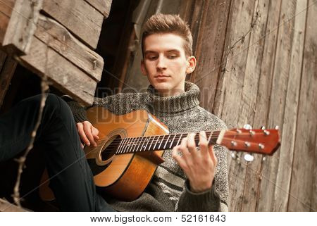 Lonely Guitarist Plays Guitar In Lost Village