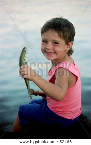 BOY CATCHES A FISH