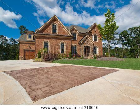 Luxury Model Home Exterior Stone Driveway Horizontal