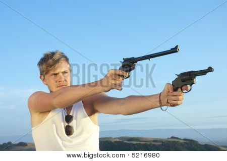 Young Man With Pistol Pointed