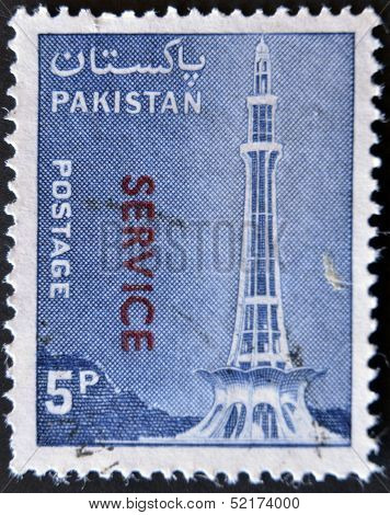 stamp printed in Pakistan shows Minar-e-Pakistan Tractor and Mausoleum of Ibrahim Khan Makli Tahtta