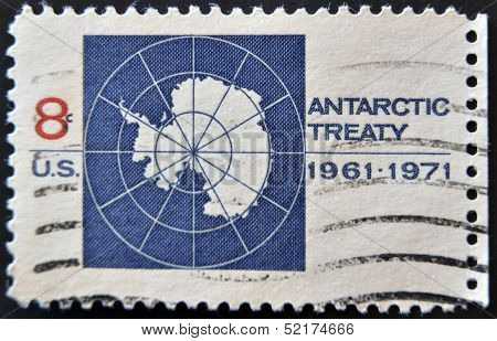 A stamp printed in the United States of America shows image celebrating the Antarctic Treaty