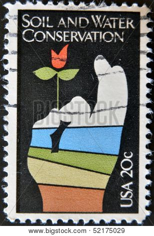 A stamp printed in USA shows image of the dedicated to the Soil and Water Conservation