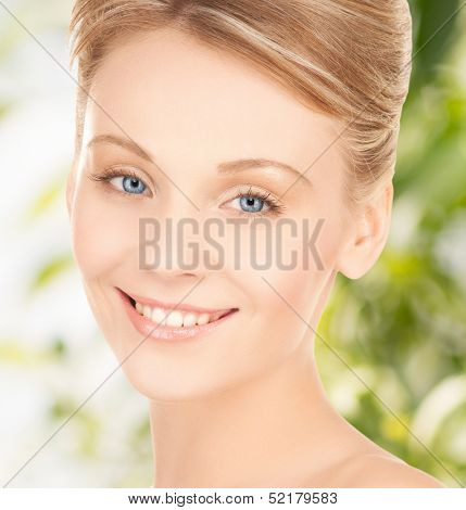 health and beauty, eco, bio, nature concept - face of beautiful woman with updo hair