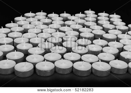 Group Of White Candles At A Black Background