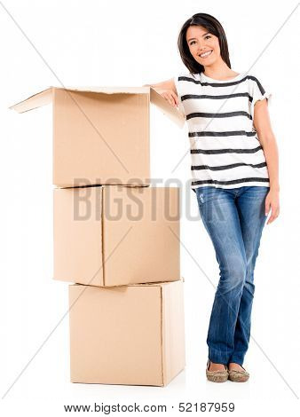 Woman moving house and packing in boxes - isolated over white