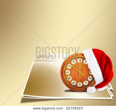 Santa Claus Hat On New Year's Night On The Old Clock Showing Twelve O'clock On The Gold Abstract Bac