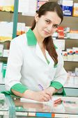pharmacist chemist woman working in pharmacy drugstore with tablet computer