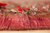 pic of rib eye steak  - Beef steak on a wooden board and table - JPG