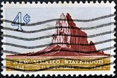 stamp shows Shiprock Mountain New Mexico Statehood 50th anniversary