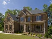foto of model home  - Model Luxury Home Exterior side view with porch - JPG
