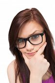 Close up on thinking brunette with glasses on white background