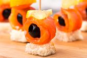 picture of canapes  - Canape with delicious salmon, olive and lemon