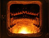 foto of blast-furnace  - Big industrial furnace with a yellow fire - JPG