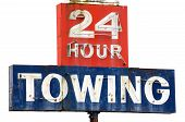 stock photo of towing  - Towing sign at a repair shop along Interstate 5 in Southern Oregon - JPG