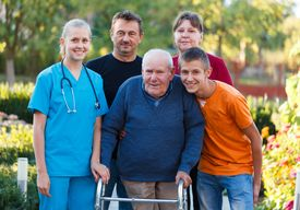 picture of rollator  - Family visiting grandfather at the nursing home helping him with the walker - JPG