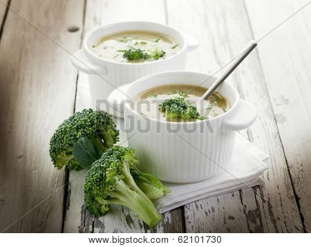 broccoli soup on bowl over wood backgroun