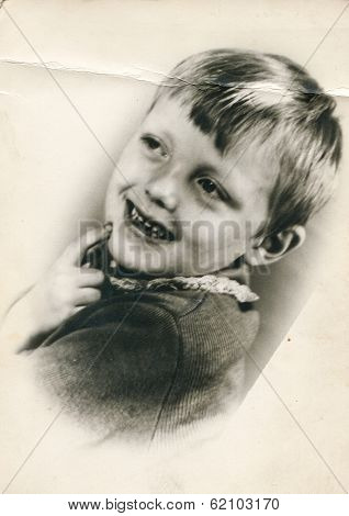 LODZ, POLAND, CIRCA 1970's: Vintage photo of little boy laughing