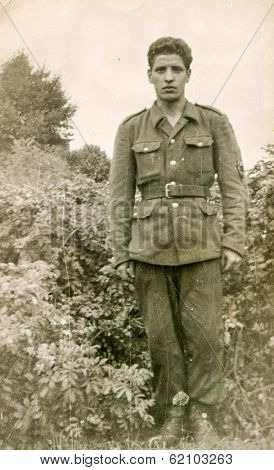 LODZ, POLAND, CIRCA 1960's: Vintage photo of soldier outdoor