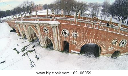 Big bridge over ravine in Tsaritsyno at winter in Moscow, Russia. Aerial view