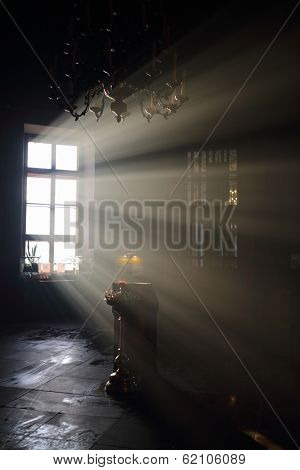Altar and sunlight in window in dark eastern orthodox temple