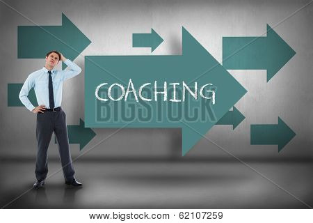 The word coaching and thoughtful businessman with hand on head against blue arrows pointing